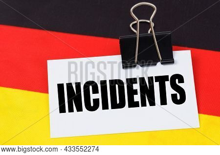 Politics And People Concept. On The Flag Of Germany Lies A Notebook With The Inscription - Incidents