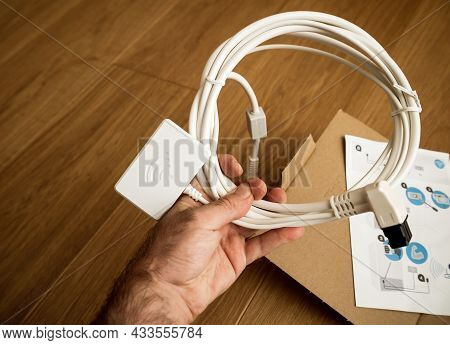Paris, France - Aug 11, 2021: Personal Perspective Male Hand Holding New Wifi Dongle For Home-connec