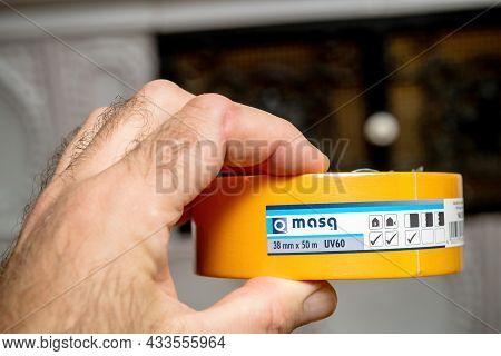 Paris, France - Sep 8, 2021: Pov Male Hand Holding New Masq Yellow Scotch Construction Tape