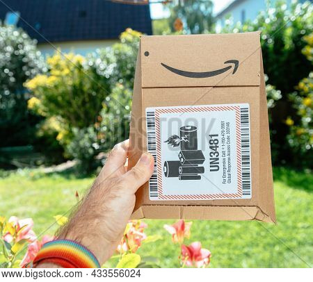 Paris, France - Sep 8, 2021: Pov Male Hand Holding Package Of Amazon Prime Cardboard Package With Un