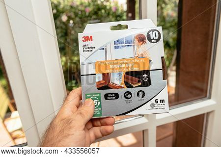 Paris, France - Sept 8, 2021: Pov Male Hand Holding Near The Window Of New Package With 3m Premium I
