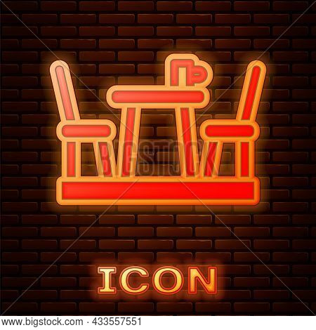 Glowing Neon French Cafe Icon Isolated On Brick Wall Background. Street Cafe. Table And Chairs. Vect