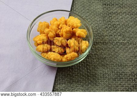 Sweet And Spicy Rice Cracker Balls In Glass Snack Bowl With Lavender Napkin