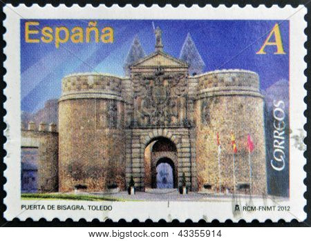 stamp printed in Spain dedicated to arches and monumental gates shows Door Hinge in Toledo