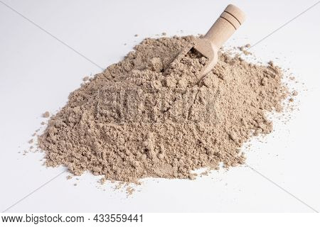 Raw Flax Seeds Flour On White Background With Wooden Scoop