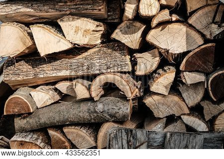 Natural Wooden Background - Closeup Of Chopped Firewood. Firewood Stacked And Prepared For Winter Pi