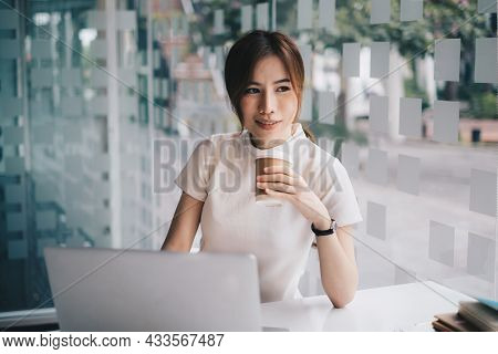 Young Undergraduate Student Studying Online Class By Laptop Computer