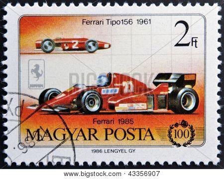 A stamp printed in Hungary shows Ferrari 1985 and ferrari tipo 156 1961