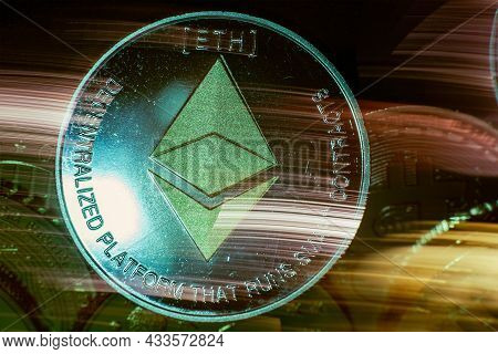 Horizontal View Of Cryptocurrency Tokens Including Ethereum Seen From Above On A Black Background Wi