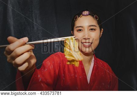 Shoot Stunning Portrait Of A Woman Wearing Red Korean Hanbok Looks At The Delicious Traditional Whit