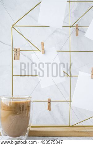 White Home Office Room Interior, Bloggers Workplace. Cup Of Coffee. Mood Board With Postcards And Re
