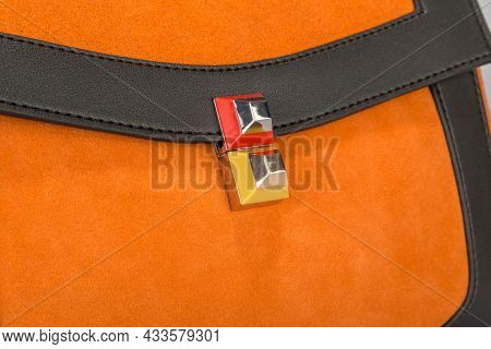 Part Of A Yellow Suede Women's Bag With A Closed Pocket Flap And A Curly Closure