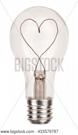 Classic incandescent light bulb with heart made of wire isolated on white background. Love concept with symbol of romance and idea photo