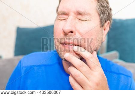 Toothache. Frustrated Young Man Touching His Cheek. Middle Age Man Is Touching His Cheek By His Hand