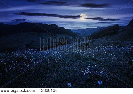 Countryside Valley Scenery At Night. Beautiful Carpathian Nature Landscape With Grassy Hills, Fields