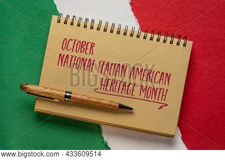 October - National Italian American Heritage Month, handwriting in a spiral notebook against paper abstract in colors of national flag of Italy (green, white and red), reminder of cultural event