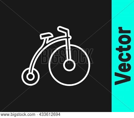 White Line Vintage Bicycle With One Big Wheel And One Small Icon Isolated On Black Background. Bike