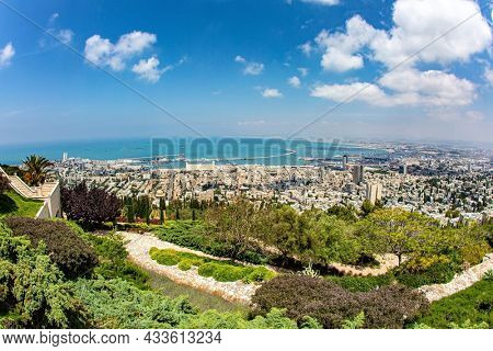 View from Mount Carmel to the international seaport of Haifa. Clear sunny day by the sea. Haifa, Israel. The descent to the Mediterranean Sea.