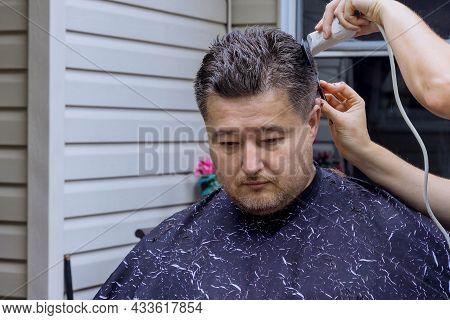 Home Haircut During Quarantine Cutting The Hair Of A Man
