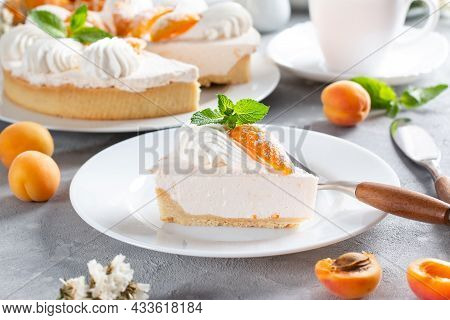 Portion Of Layered Cheesecake With Apricot On Light Background. Apricot Tart. Fruit Pie. French Past