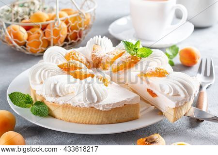 Cheesecake With Yogurt And Apricot On A Light Background. Apricot Tart. Fruit Pie. French Pastries
