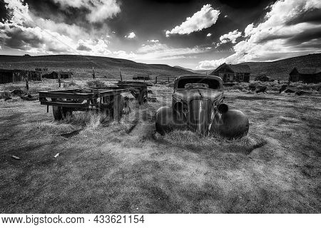 BODIE, CALIFORNIA, USA - MAY 5, 2015: Wreck of a ancient rusty car in a ghost town of Bodie. Bodie is a National Historic Landmark. It is located in Mono County, Sierra Nevada - California. USA