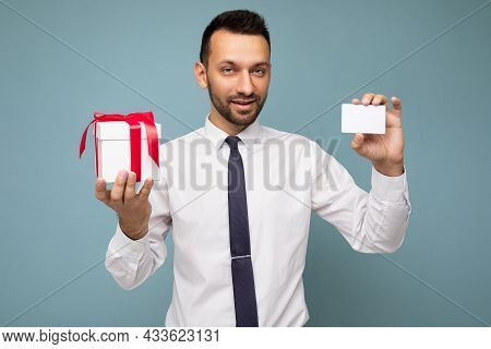 Photo Shot Of Handsome Happy Brunette Young Unshaven Man With Beard Isolated Over Blue Background Wa