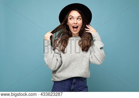 Young Beautiful Surprised Positive Happy Brunet Woman. Trendy Lady In Casual Grey Sweater And Stylis