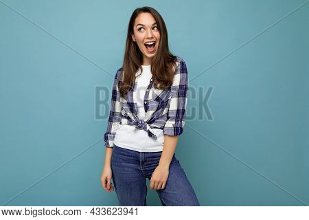 Young Beautiful Brunet Woman. Trendy Lady In Casual Summer Hipster Shirt . Positive Female Shows Fac