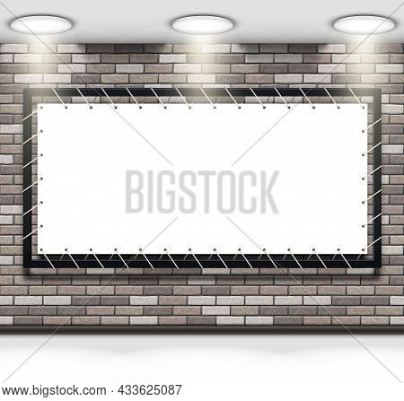 Stretch Fabric Banner In A Metal Frame On A Gray Brick Wall Illuminated By A Ceiling Lamps. Mockup W