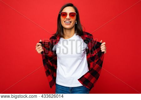 Portrait Of Positive Cheerful Smiling Young Brunette Woman In Casual White T-shirt For Mockup, Styli