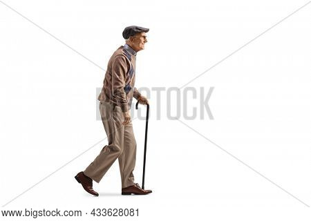 Full length profile shot of an elderly man with a walking cane in his hand isolated on white background