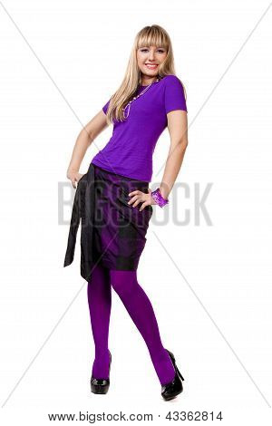 Beautiful girl in purple clothes posing with silver necklace and black shoes