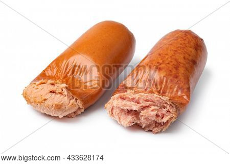 Traditional German coarse and fine Teewurst open in plastic close up isolated on white background