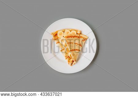 Person Eating Crepe With Filling. Tasty Breakfast.