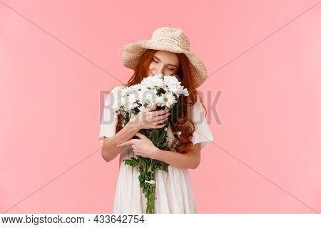 Romance, Love And Relationship Concept. Romantic Dreamy, Alluring Redhead Girl Sniffing Flowers, Clo