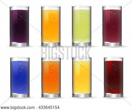 A Set Of Glasses With Multi-colored Liquids.multi-colored Juices In Glass Glasses On A White Backgro