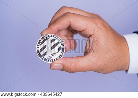 Litecoin Ltc Included With Cryptocurrency On Hand Business Man Wearing A Blue Suit. Filed And Put An