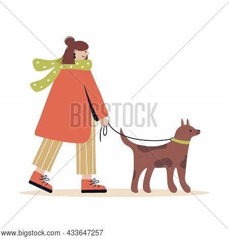 Female Character Is Walking The Dog. Young Woman In A Scarf And Coat On A Walk With The Dog. Outdoor