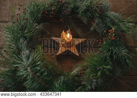 Christmas Advent. Stylish Christmas Wreath With Rustic Burning Candle On Old Wooden Background. Merr