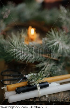 Stylish Candles And Christmas Wreath On Rustic Wooden Background. Christmas Advent. Merry Christmas