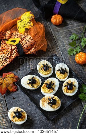 Halloween Funny Idea For Party Food. Halloween Creative Set Stuffed Eggs With Paprica And Bat On A W