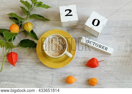Calendar For October 20 : The Name Of The Month In English, Cubes With The Number 20, A Yellow Cup W