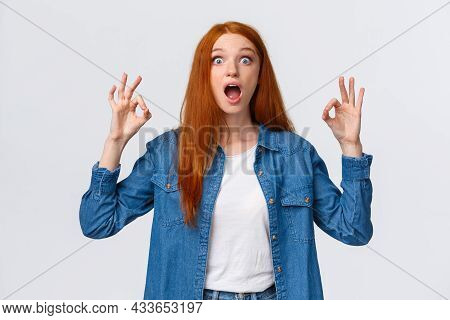 Amused, Excited And Thrilled Good-looking Redhead Female In Denim Shirt, Open Mouth, Drop Jaw Speech