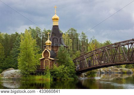 View Of The Temple Of The Apostle Andrew The First-called On The Vuoksa River, A Small Wooden Church