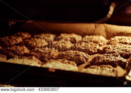Baking Tray With Chip Oatmeal Cookies In Oven. Homemade Dessert. Culinary Recipe With Oat Flakes. Us