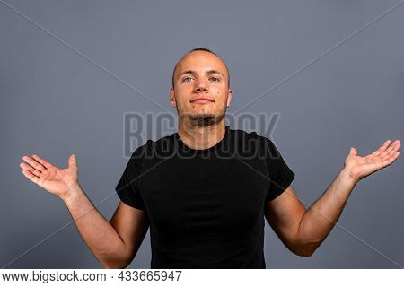 I Dont Know. Portrait Of Confused Handsome Young Man In Blue Casual Style Black Shirt Looking At Cam