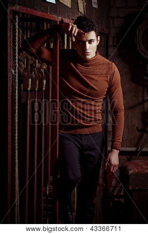 Beautiful man in fashionable clothes. Fashion portrait