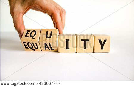 Equity And Equality Symbol. Businessman Turns Wooden Cubes And Changes The Word 'equality' To 'equit