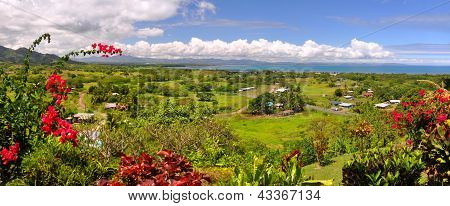 Panorama of the Fijian west coast. In the foreground Hibiscus - the Fijian national symbolic flower. In the background Nadi and Denarau Island. poster